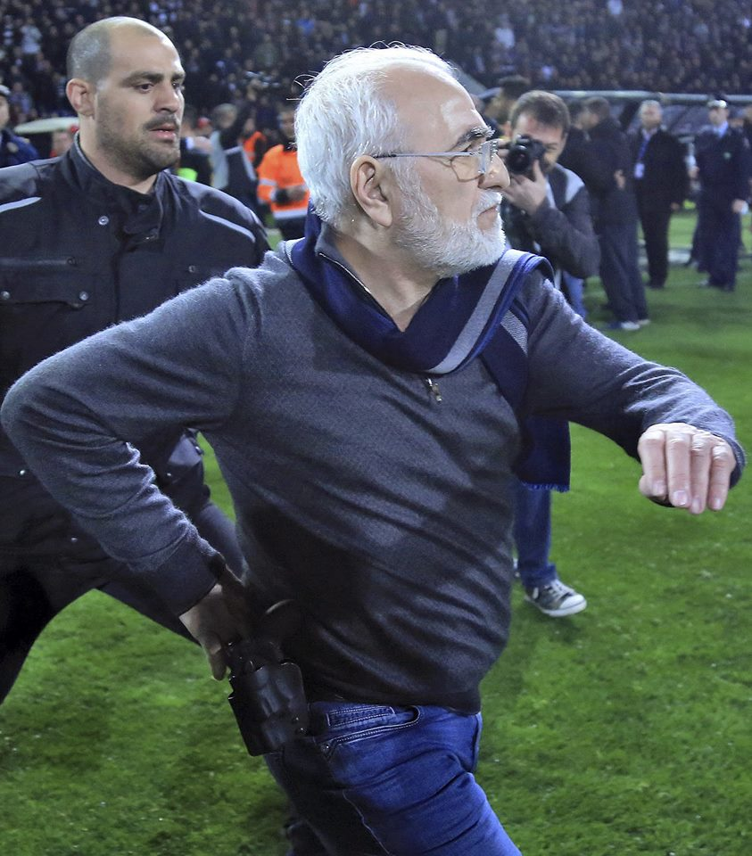 Greek game abandoned as PAOK chief enters pitch with gun