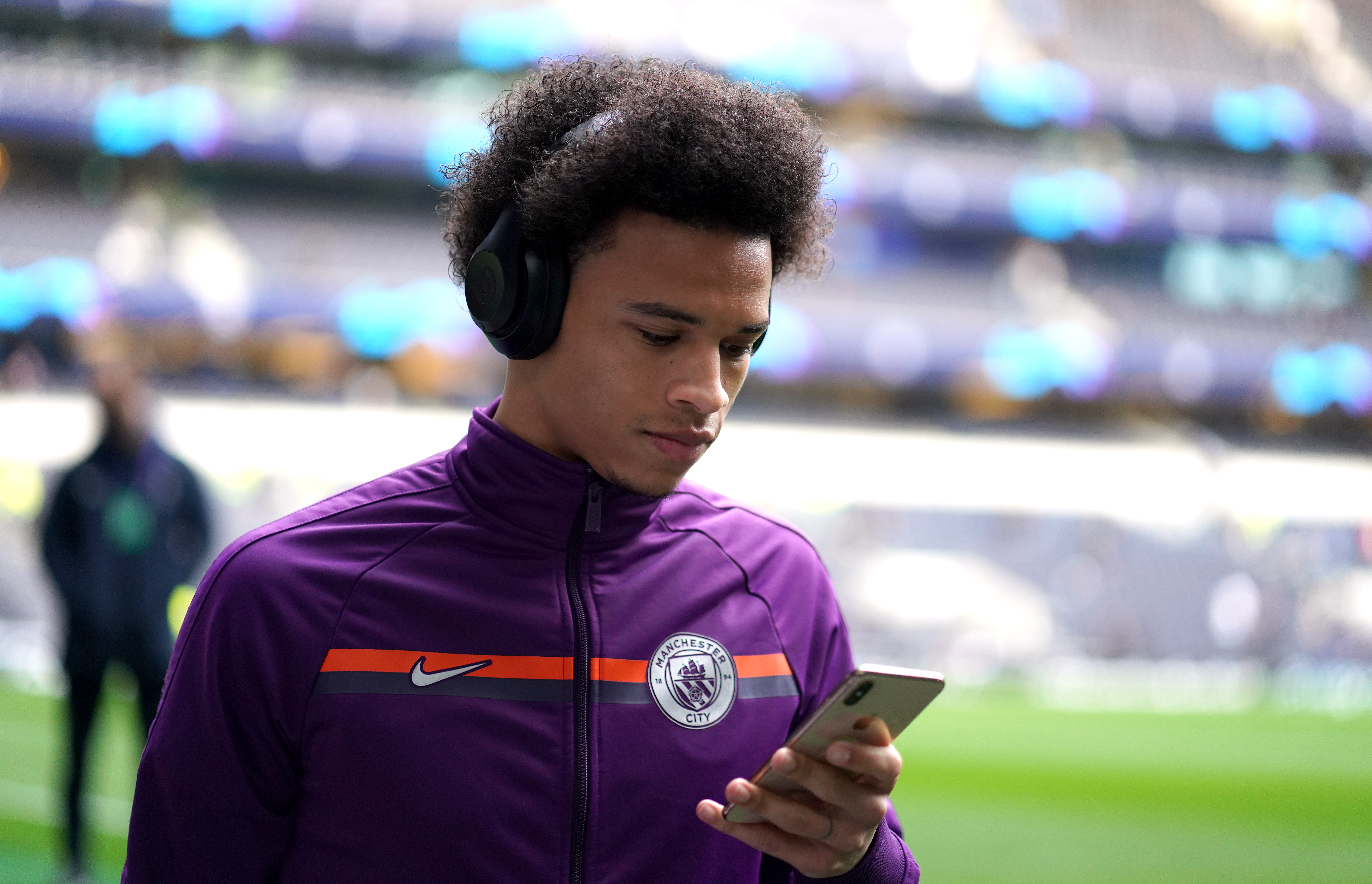 Sane checking his phone for transfer updates. Image: PA Images
