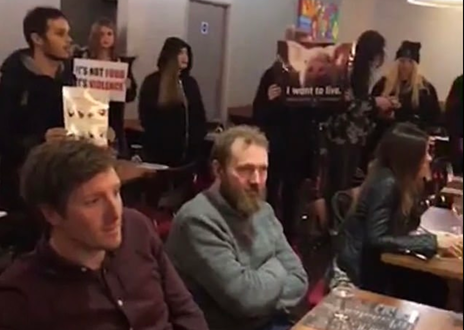 Vegan activists storm steakhouse, are mocked by patrons mooing at them