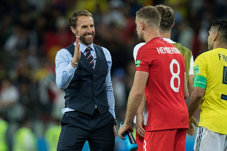 Gareth Southgate congratulates Jordan Henderson following victory over Sweden. Credit: PA