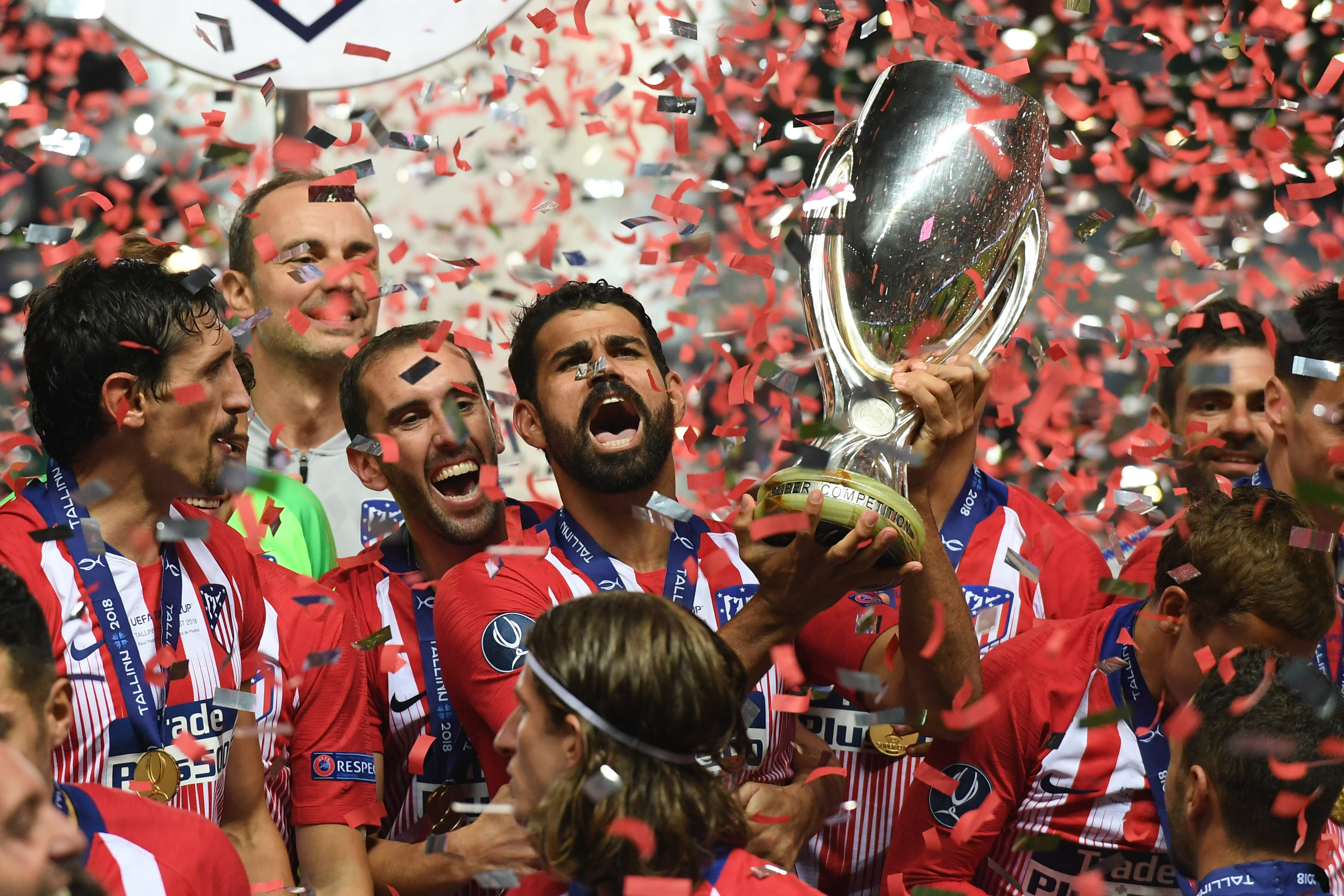 Costa holds aloft the Super Cup. Image: PA