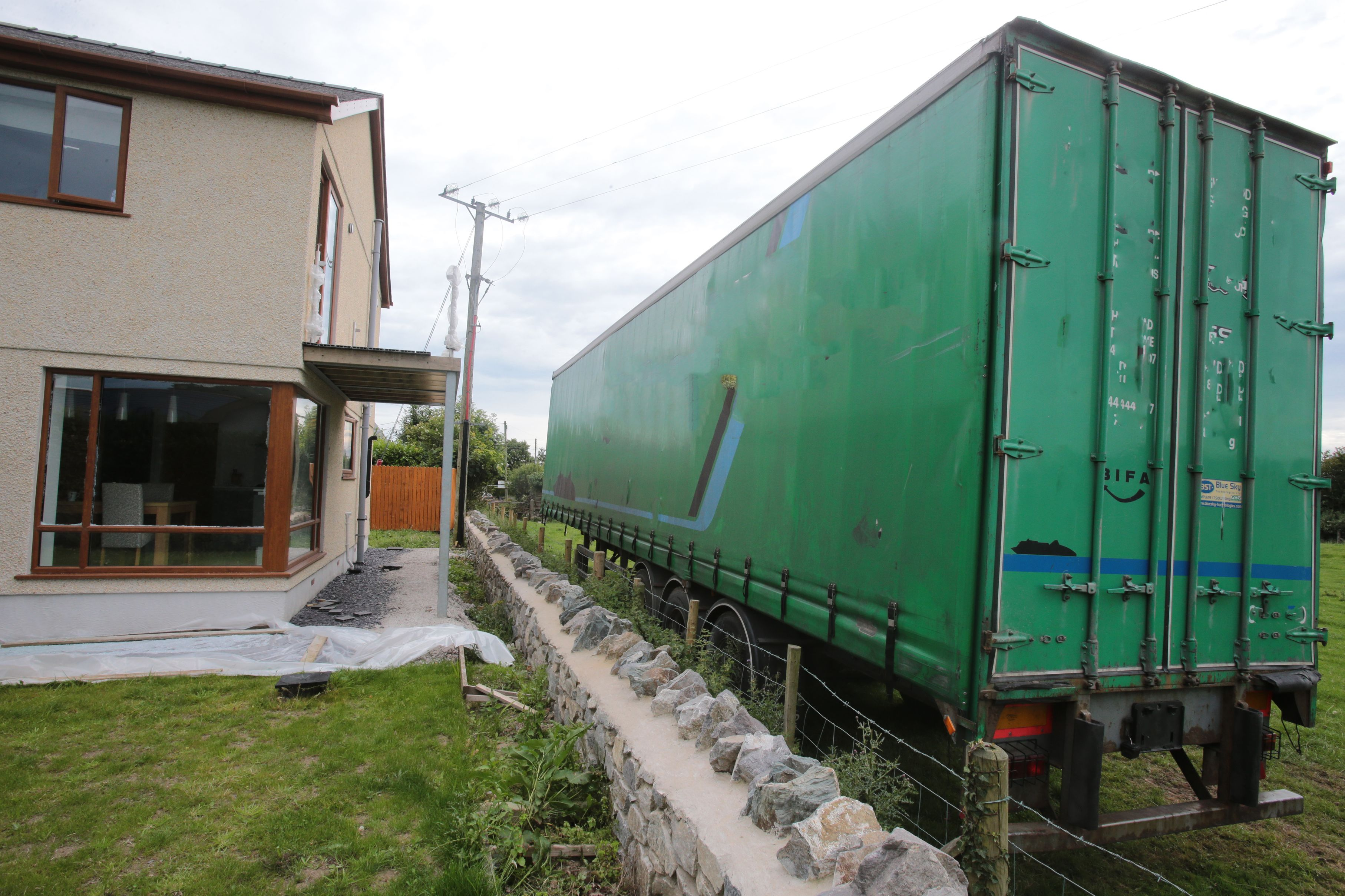HGV container outside house