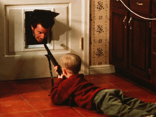 Marv comes up against an armed Kevin McAllister in Home Alone. Credit: 20th Century Fox