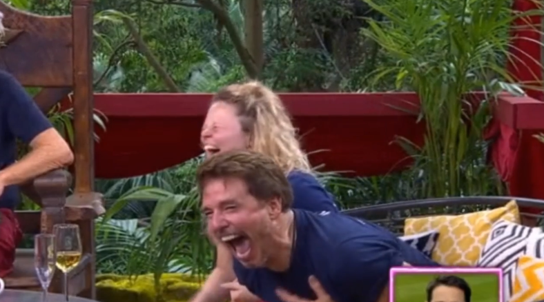 Emily and John giggling together while they chat to Jamie Redknapp over the phone. Credit: ITV