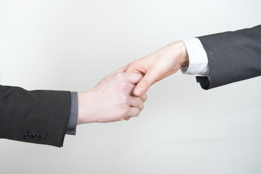Handshakes could be banned in the workplace. Credit: PA
