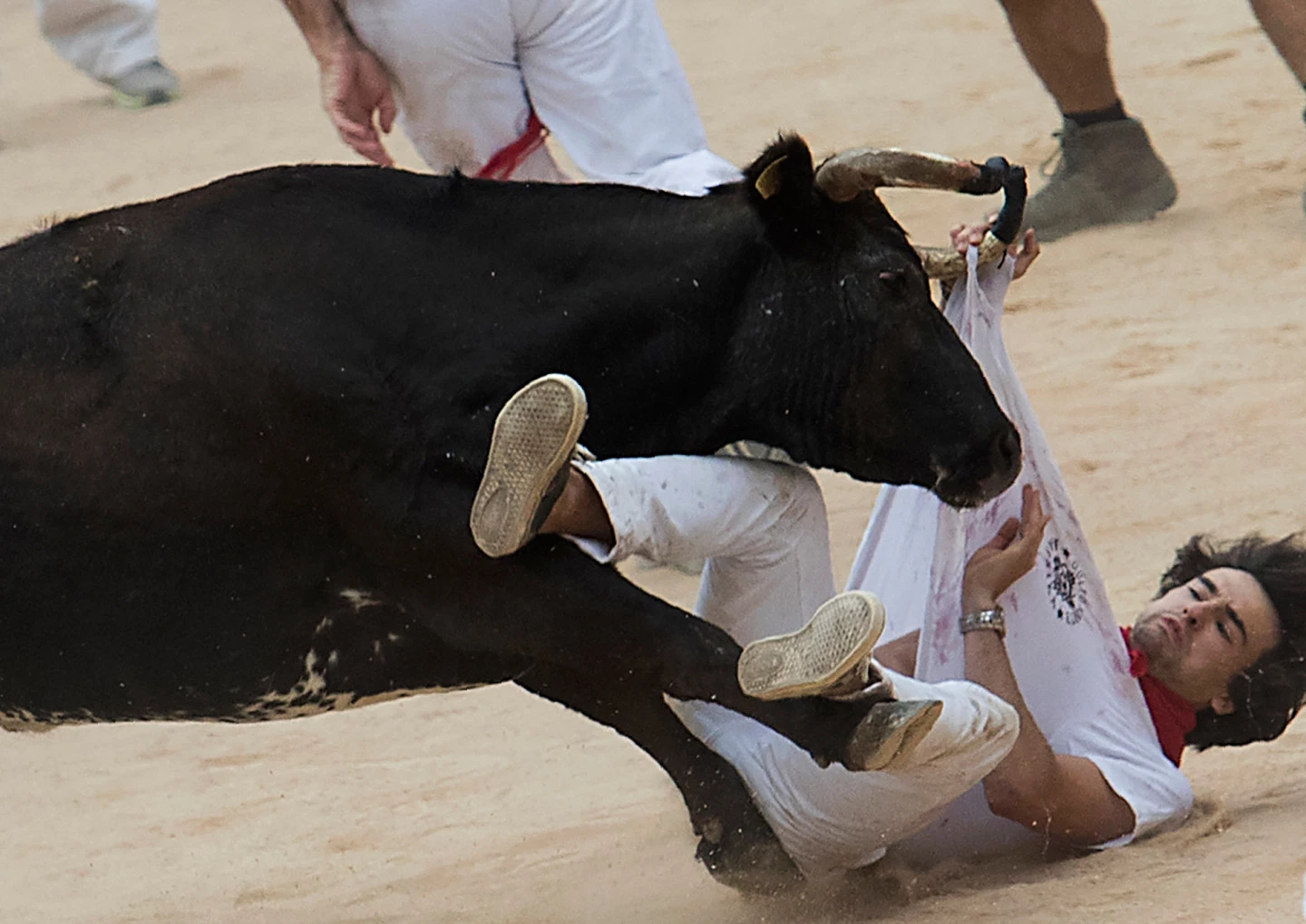 A man is struck by one of the bulls. Credit: JAIME REINA/AFP/Getty Images