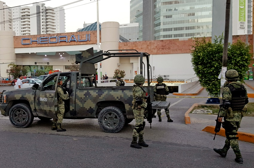 Soldiers on guard after an attack in Cancun. Credit: PA