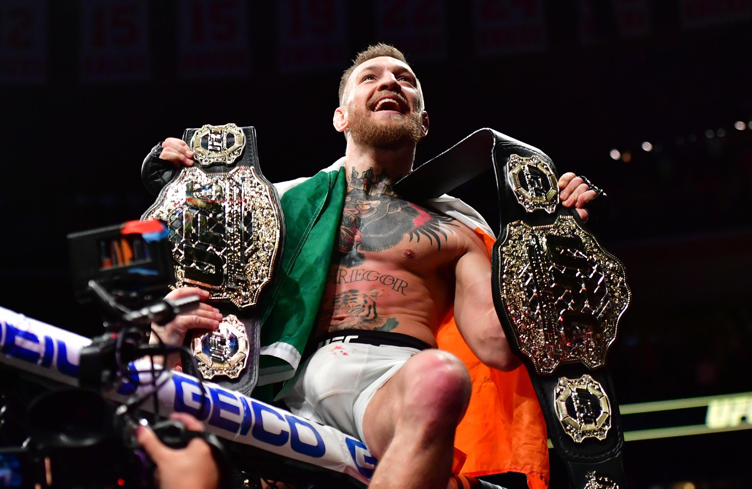 McGregor makes history at UFC 205. Image: PA