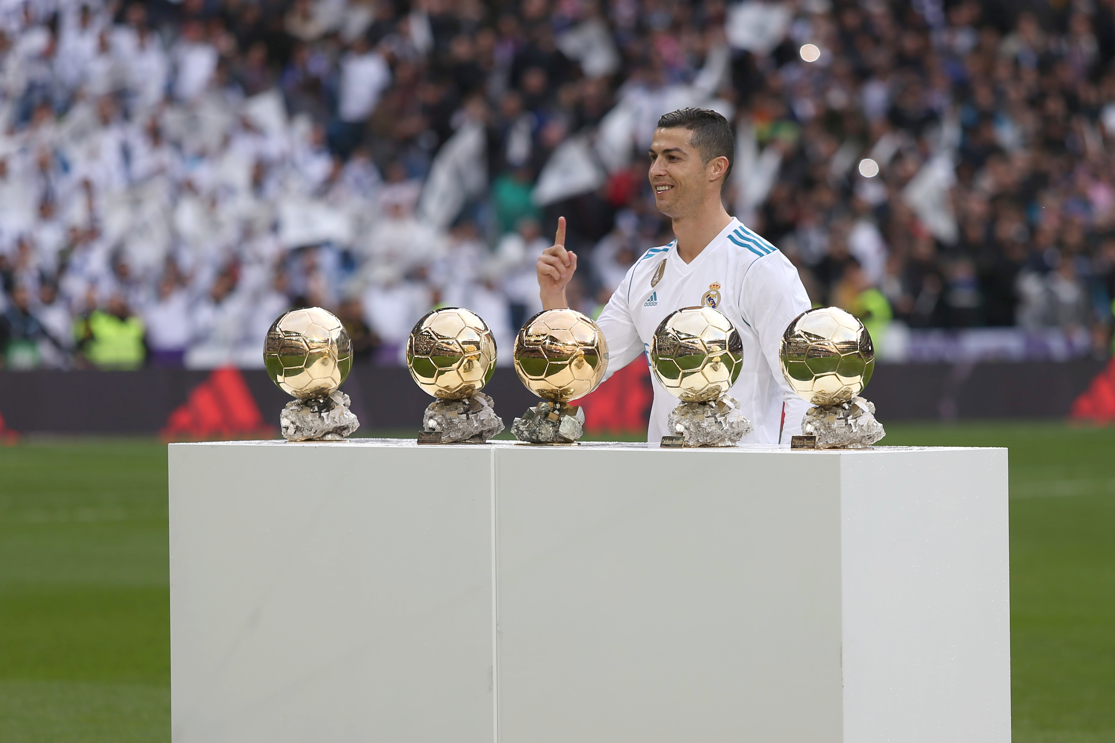 Ronaldo with his Ballon d'Ors. Image: PA Images