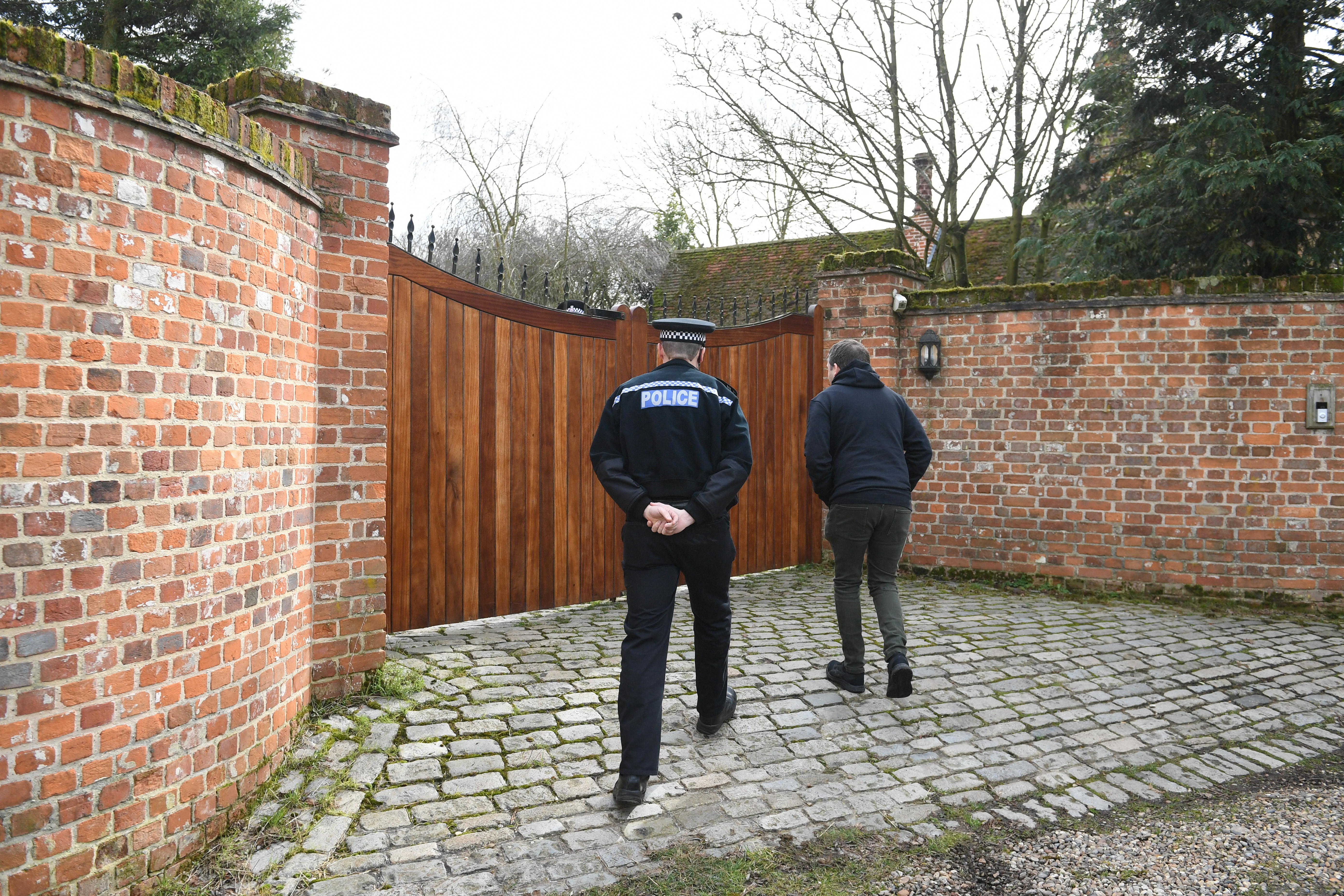 Police outside Keith Flint's house in Essex this morning. Credit: PA