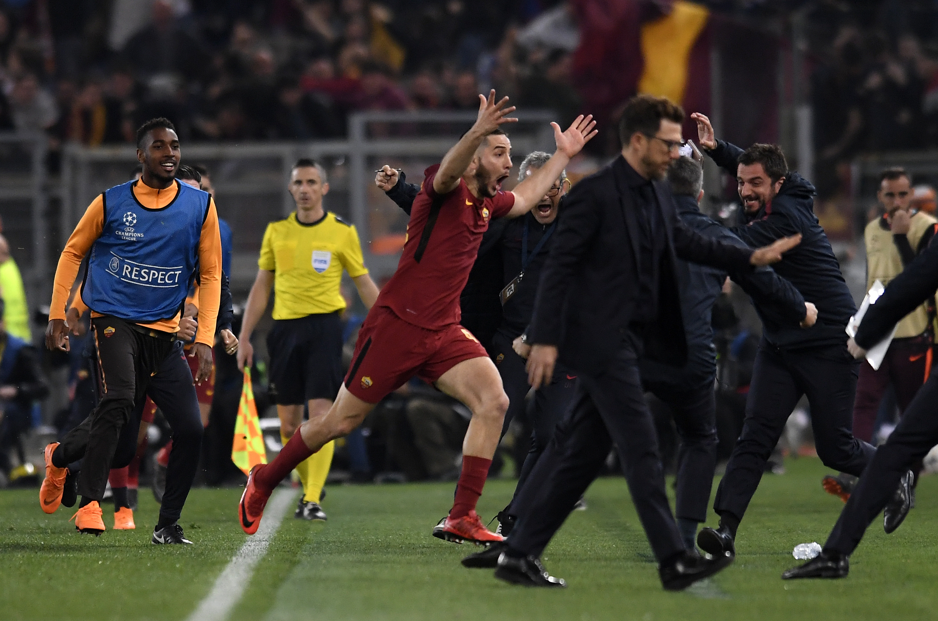Manolas wheels away in celebration after scoring. Image PA