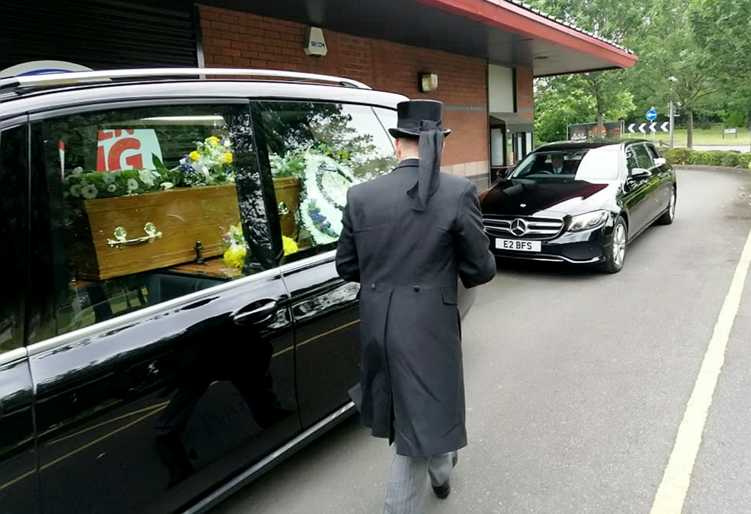 The hearse goes through the drive-thru. Credit: SWNS