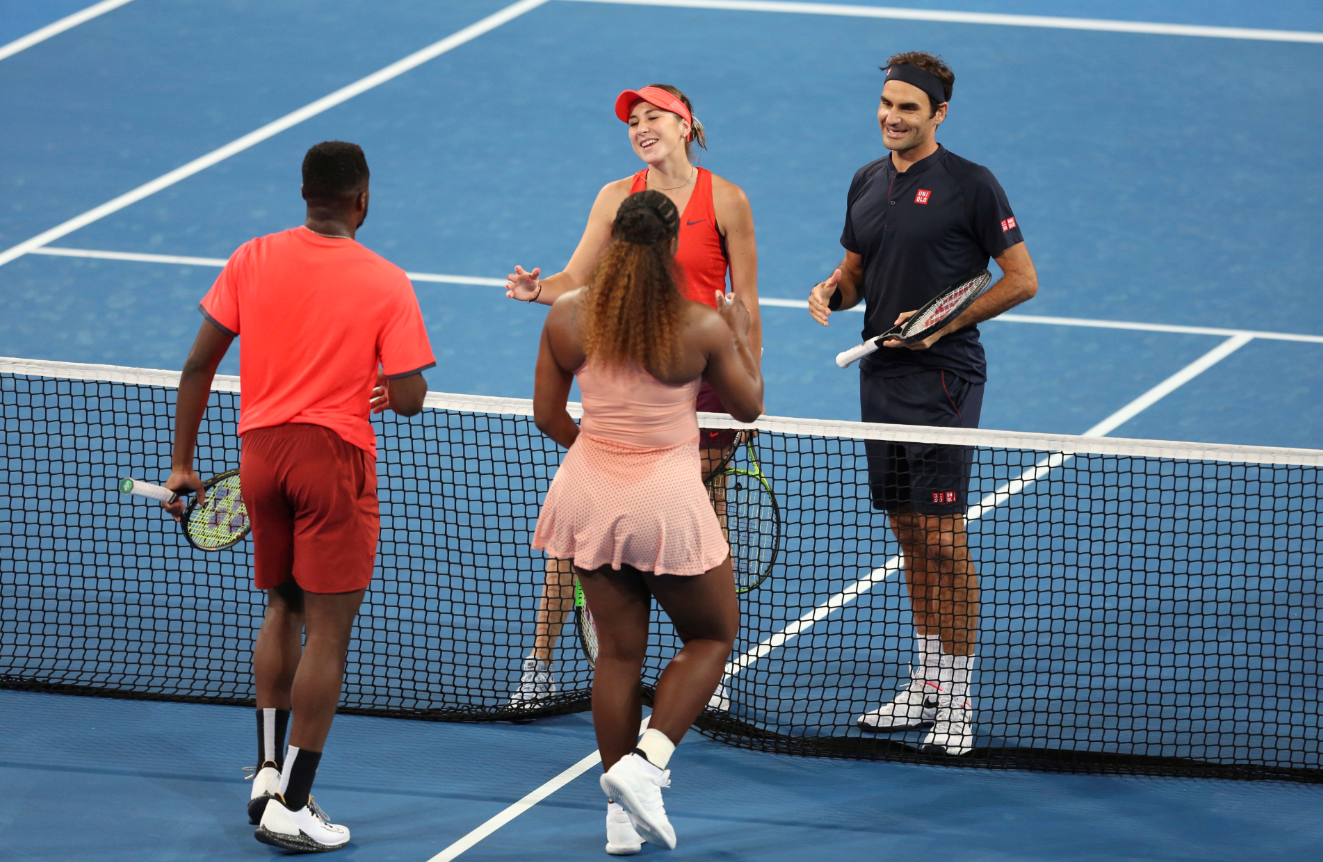 Federer and Swiss teammate Belinda Bencic beat Williams and Frances Tiafoe. Credit: PA