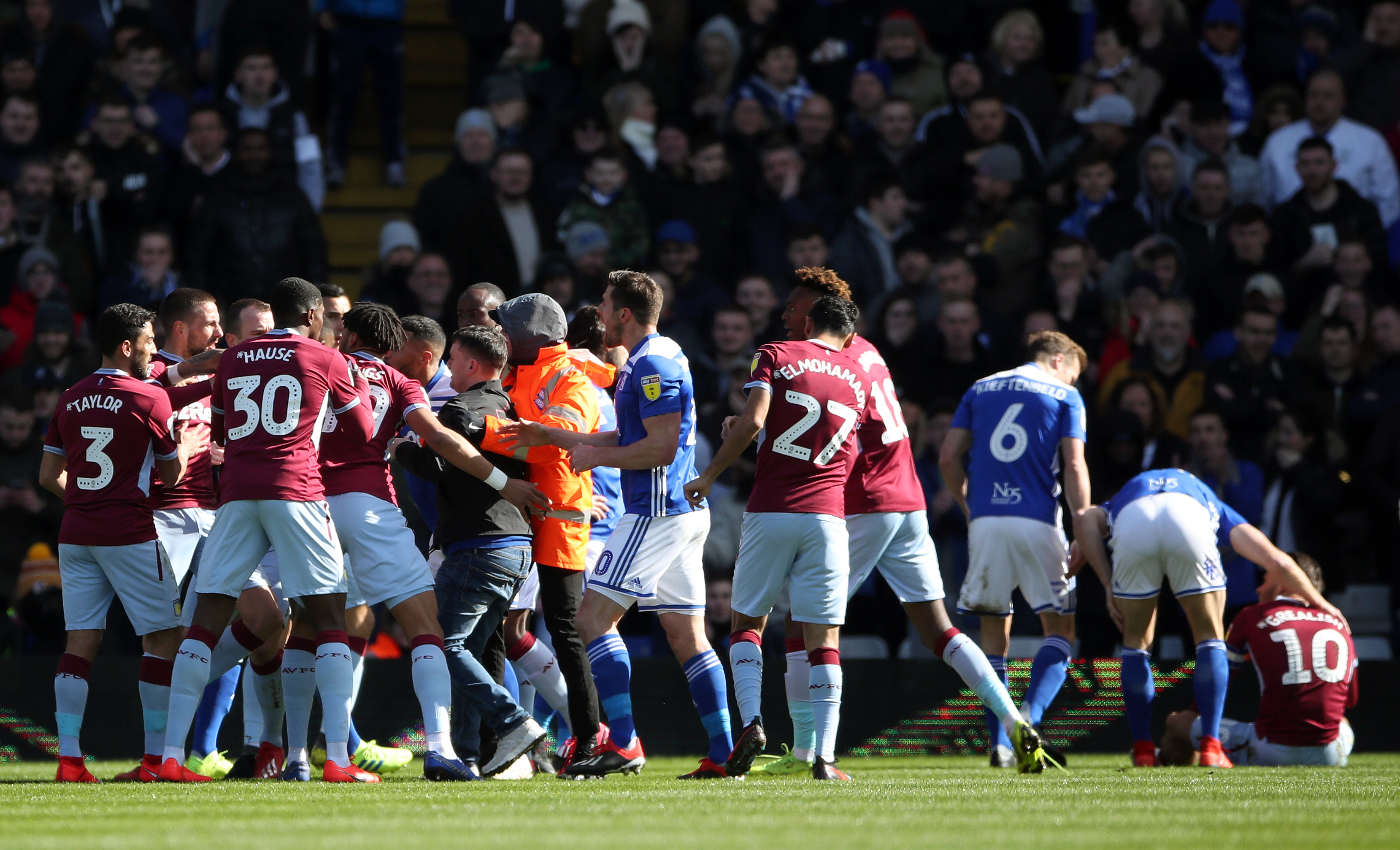 Fan attacks Aston Villa player Jack Grealish on pitch during Championship match