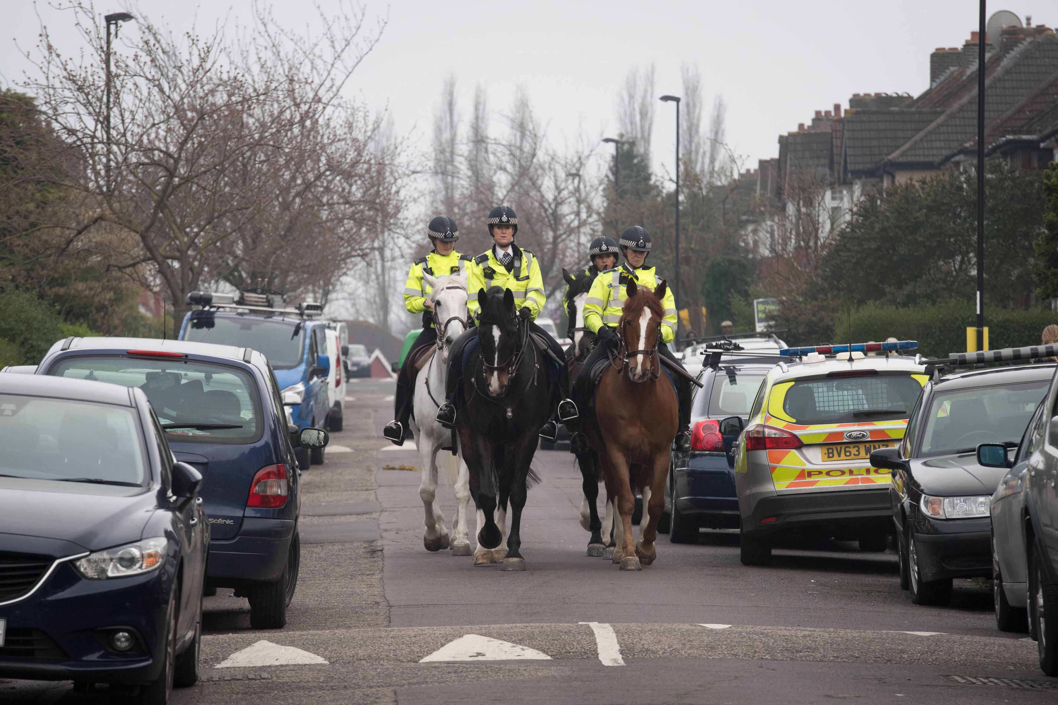 Police patrol the streets in Hither Green. Credit: PA