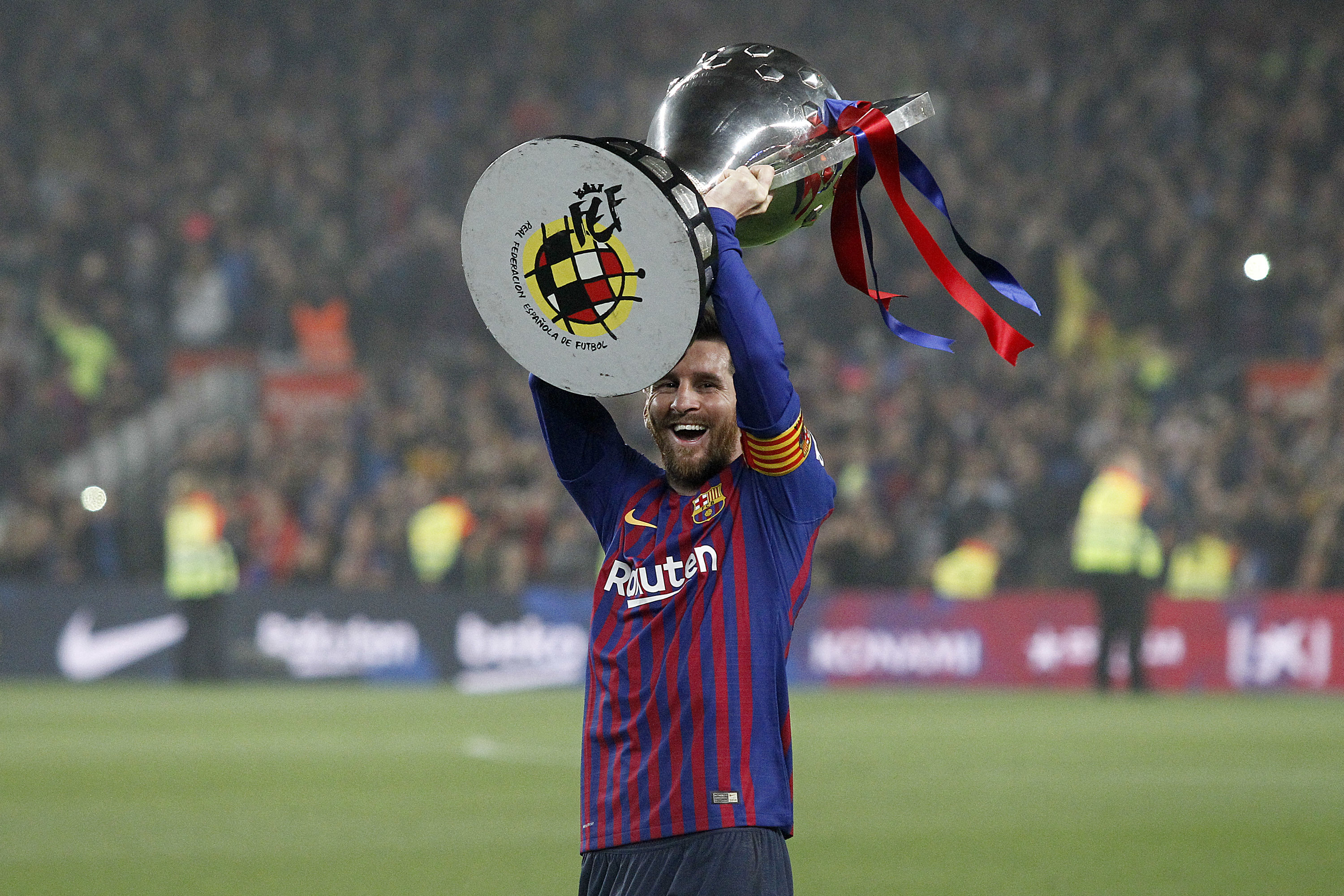 Messi with his latest La Liga trophy. Image: PA Images
