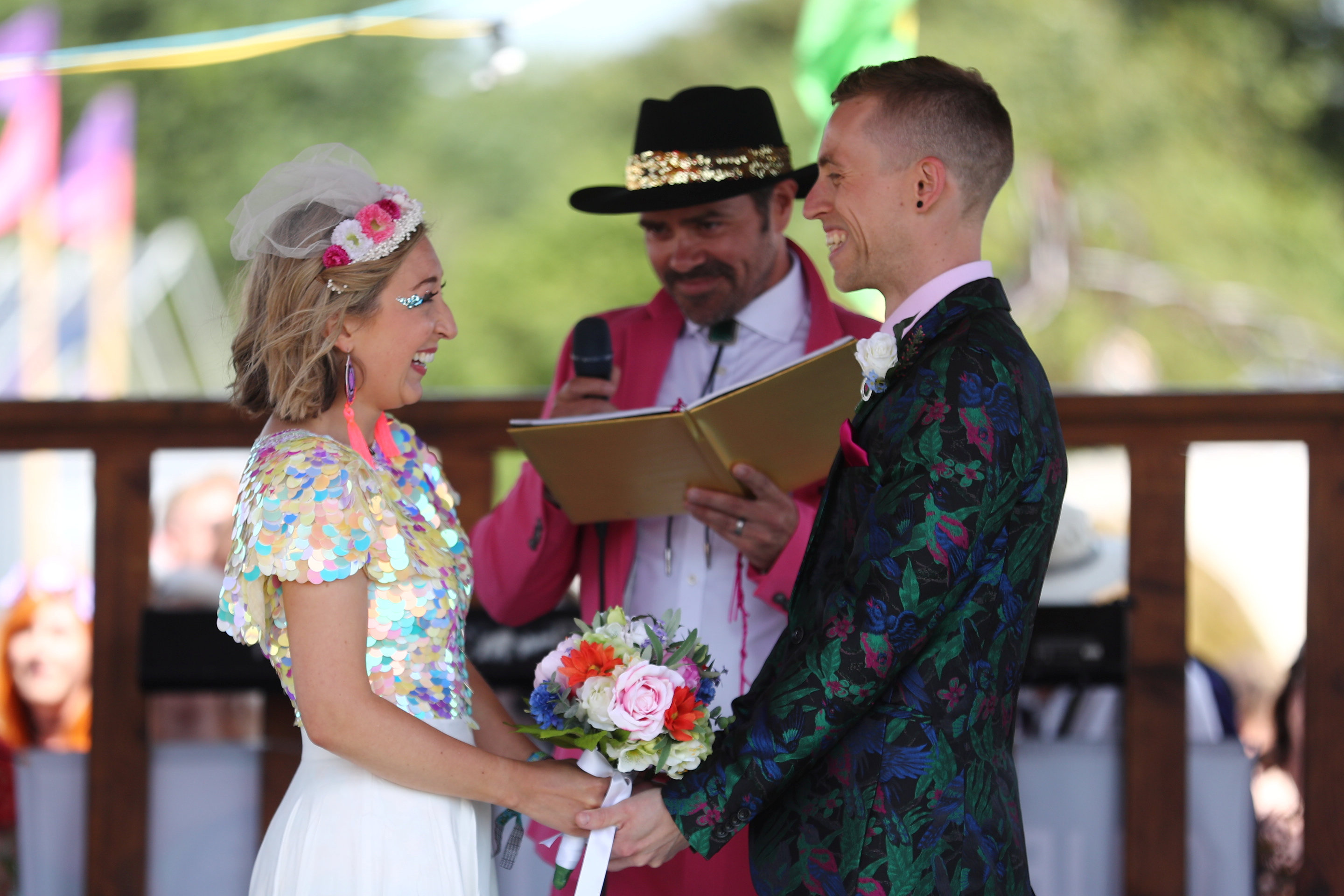 The happy couple on their wedding day at Glastonbury Festival. Credit: SWNS