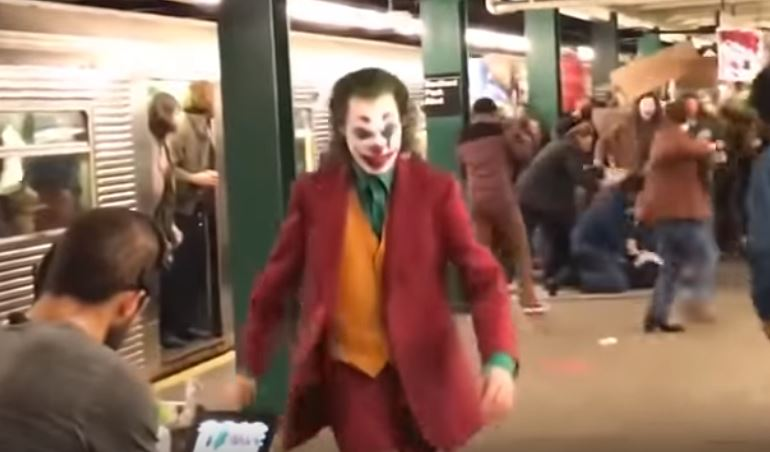 Joaquin Phoenix Terrorizes a Subway Platform in 'Joker' Set Video