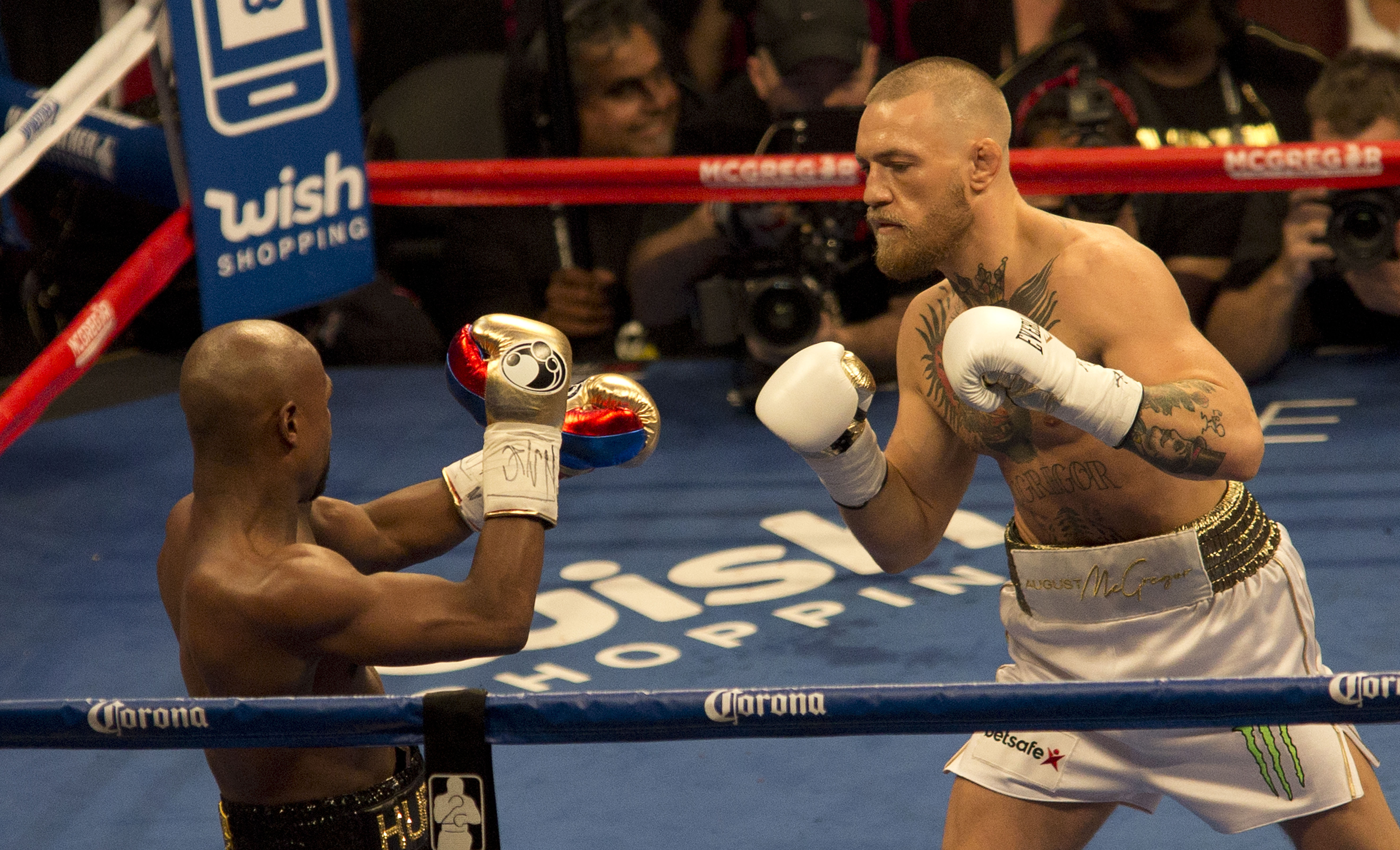 Conor McGregor in the boxing ring against Floyd Mayweather. Credit: PA