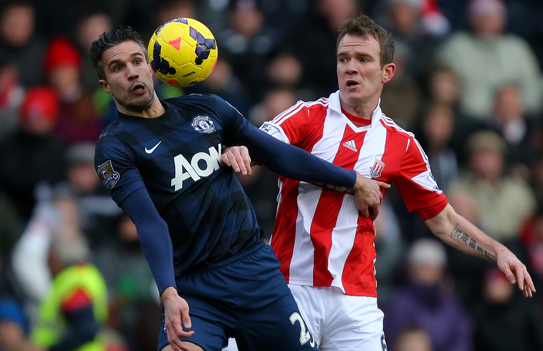 van Persie competing for the ball against Whelan. Image: PA