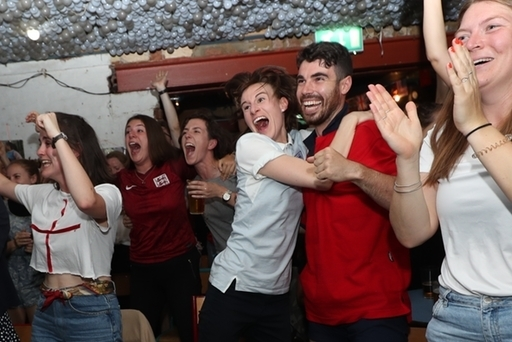 England supporters watch the England vs USA semi-final. Credit: PA