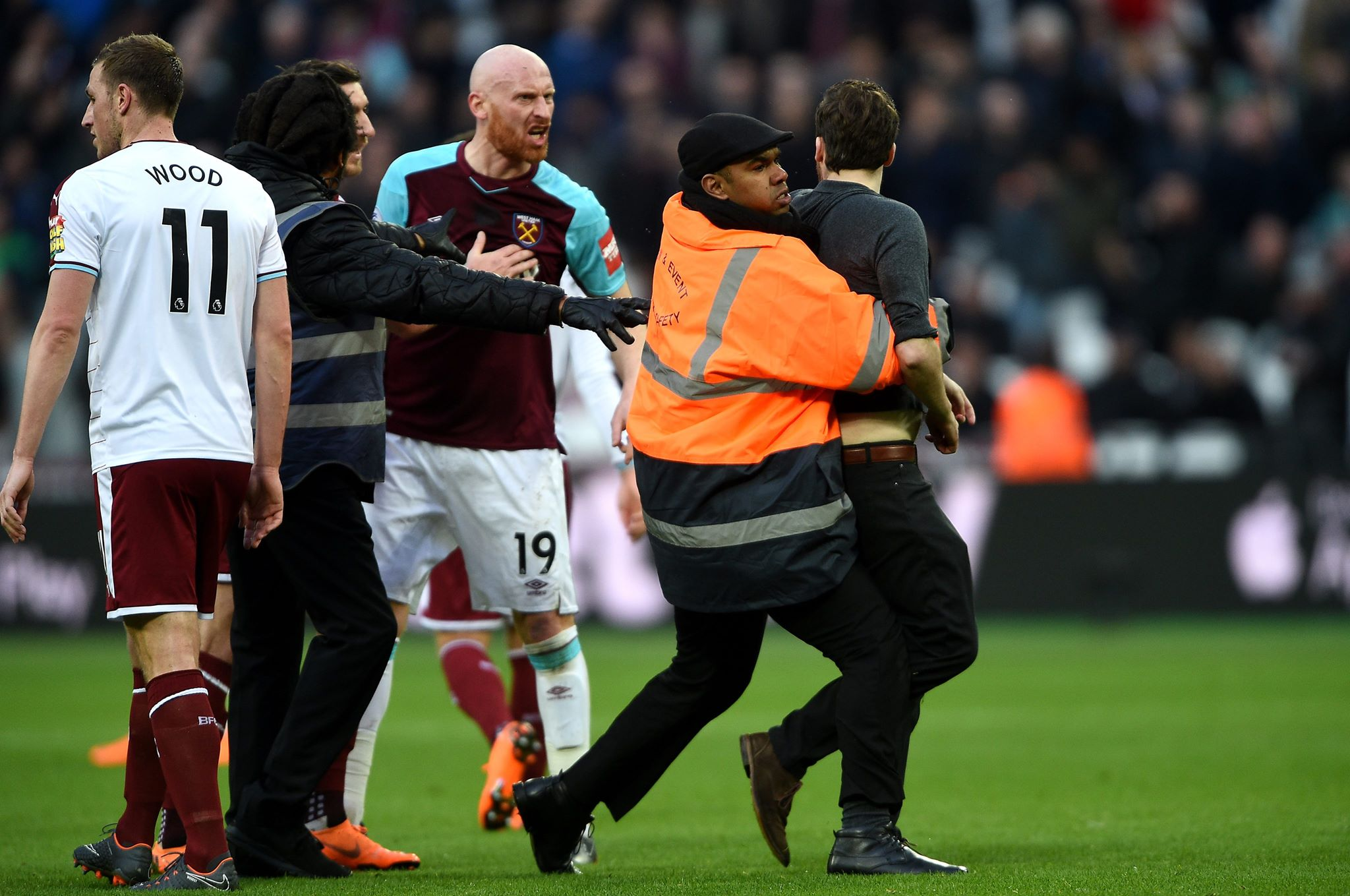 Pitch invader confronts James Collins. Image PA
