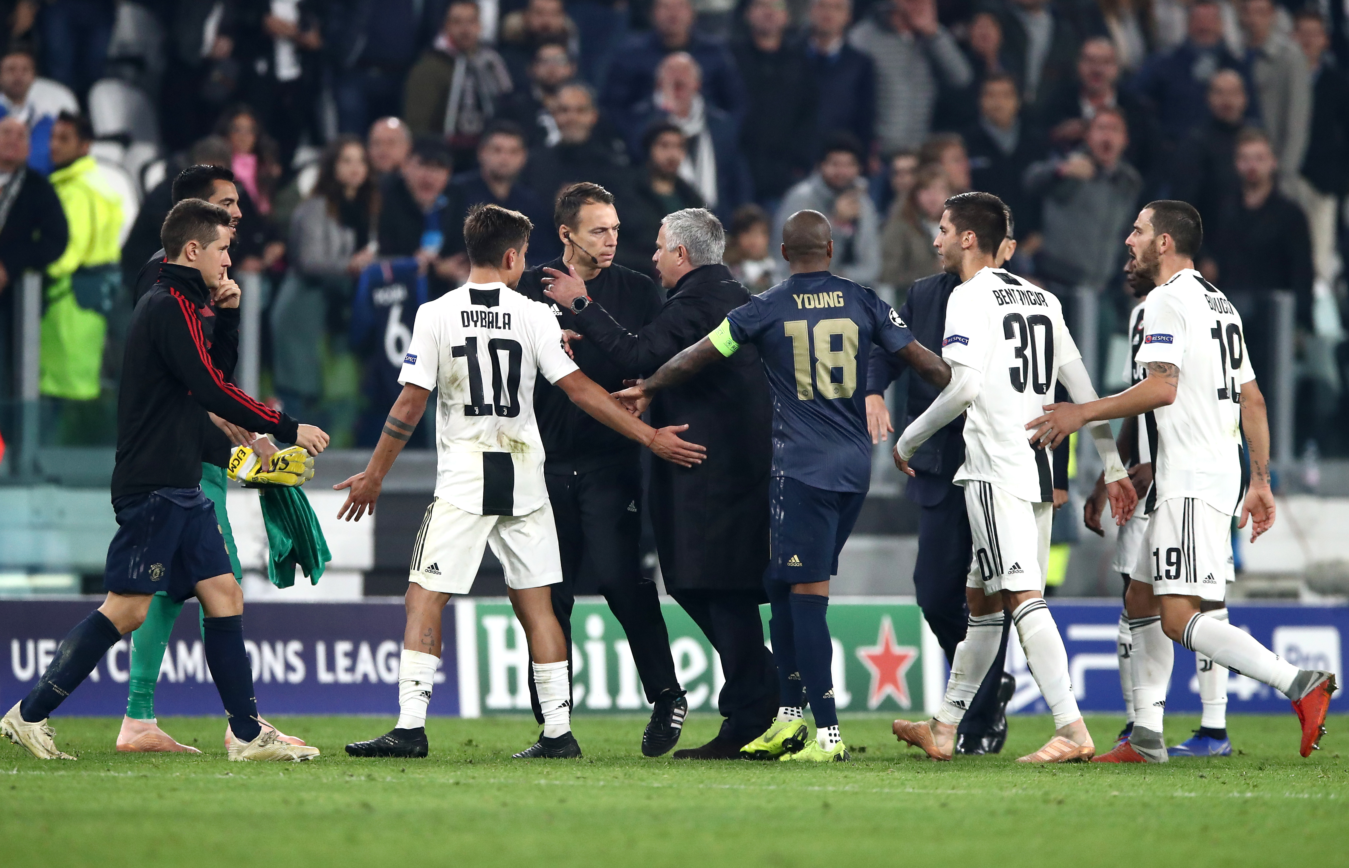 Juventus players surround Mourinho after his final whistle antics. Image: PA Images