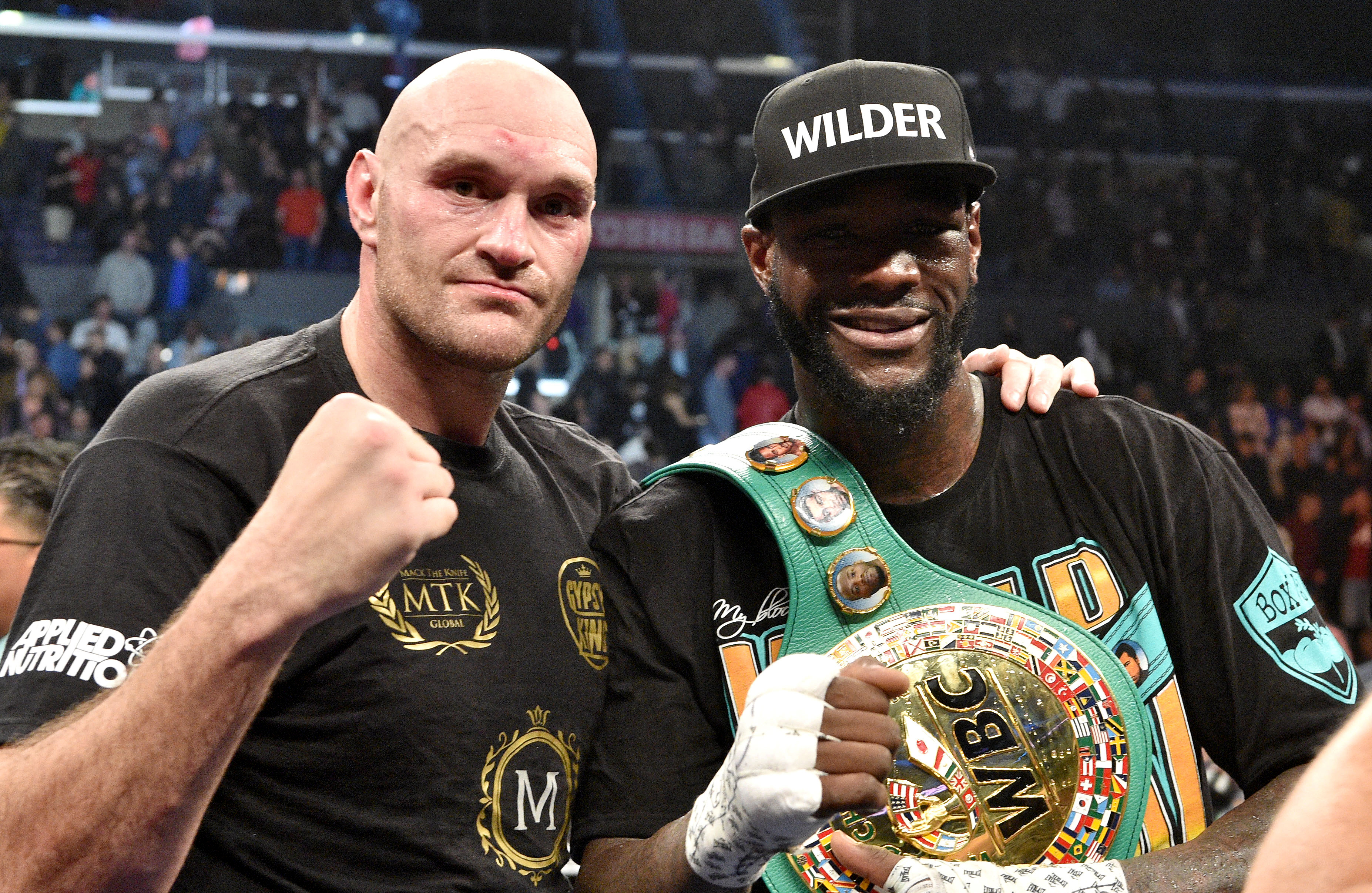Tyson Fury and Deontay Wilder. Credit: PA