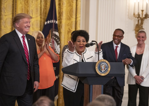Alice Johnson, a convicted drug trafficker who served 21 years in prison, and who was pardoned after the intervention of Kim Kardashian, with United States President Donald J. Trump. Credit: PA