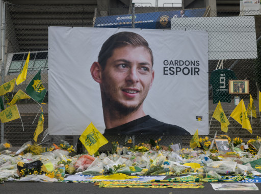 Wreaths and flowers in memory of Emiliano Sala, in front of the Beaujoire Stadium in Nantes. Credit: PA